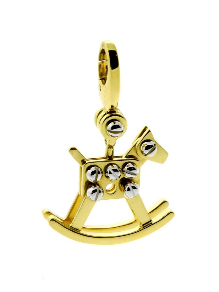 Cartier Rocking Horse Charm Pendant in 18k White & Yellow Gold  Hallmarks: Cartier, 2000, 750, Serial Number Weight: 5.9 Grams Dimensions: 18mm Wide (.70″ Inches) by 29mm in Length (1.14″ Inches)  Inventory ID: 0000116