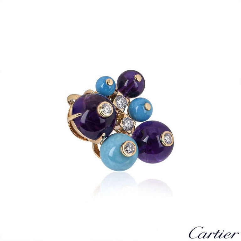 An 18 carat rose gold multi-gem Delices De Goa pendant. The pendant is made up of a cluster of amethyst and turquoise balls, complemented by round brilliant cut diamonds. The diamonds have a total weight of approximately 0.41 carats. The pendant