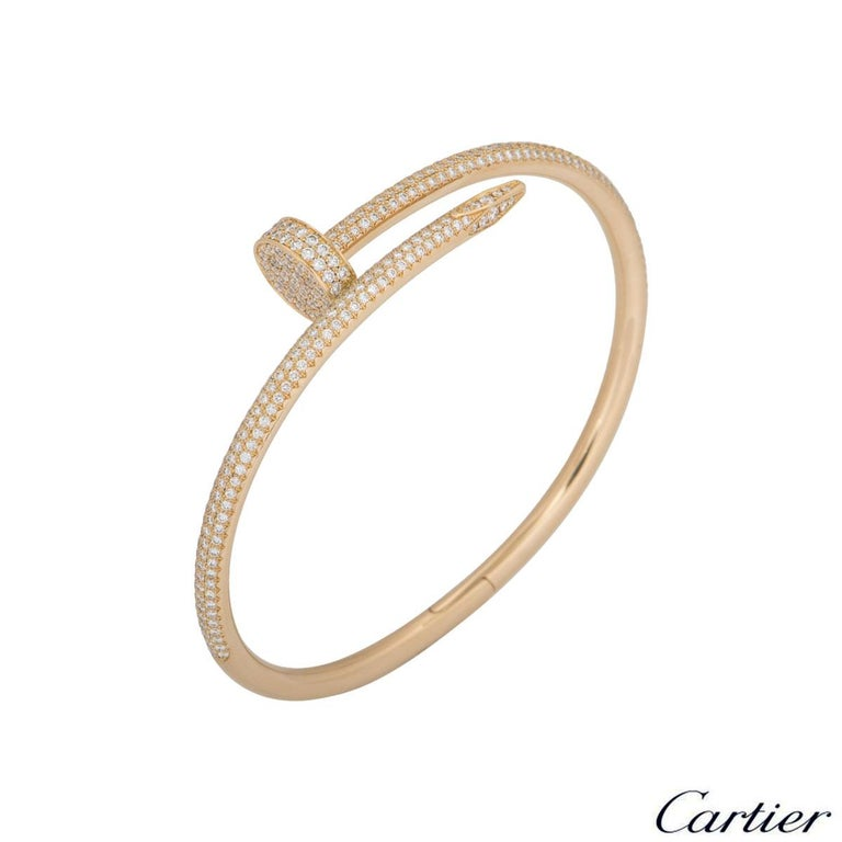 A stunning 18k rose gold diamond bangle by Cartier from the Juste Un Clou collection. The bangle is of a nail design, fully pave set around the outer side with 374 round brilliant cut diamonds totalling 2.26ct. The bangle measures 3.5mm at the