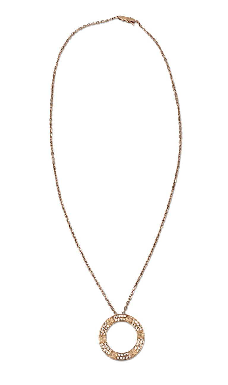 Authentic chain and ring charm necklace from the Cartier Love collection. Made in 18 karat rose gold and oval link chain with a half inch round ring and screw top motifs set with round brilliant cut diamonds (F color, VS clarity) of approximately
