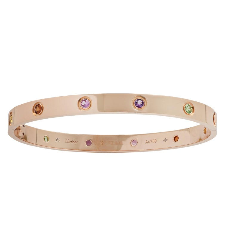 Cartier LOVE bangle crafted in 18 Karat Rose Gold, featuring 2 green garnets, 2 purple amethysts, 2 rose sapphires, 2 orange garnets and  2 yellow sapphires. The Cartier love collection is a timeless tribute to the symbol of love that transcends