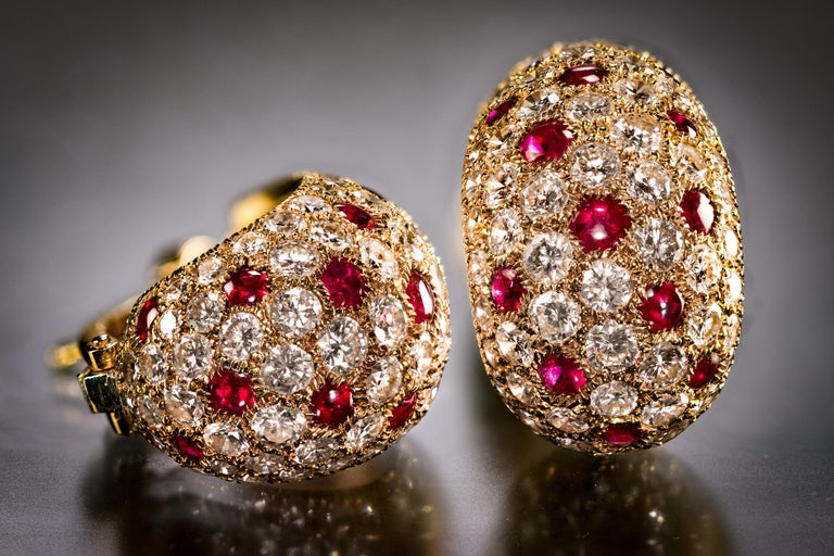 Of bombe design, these very special and wearable earrings are set with brilliant-cut diamonds and buff-top, circular-cut rubies. It is very rare to see this design in ruby and diamond, much more common in blue sapphire and diamond.  ·     Length is