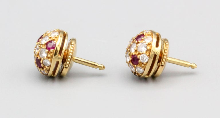 Fine pair of ruby, diamond and 18K yellow gold stud earrings by Cartier. They feature rich red rubies, along with high grade round brilliant cut diamonds on an 18K yellow gold setting. Impeccable workmanship and easy to wear.  Hallmarks: Cartier,