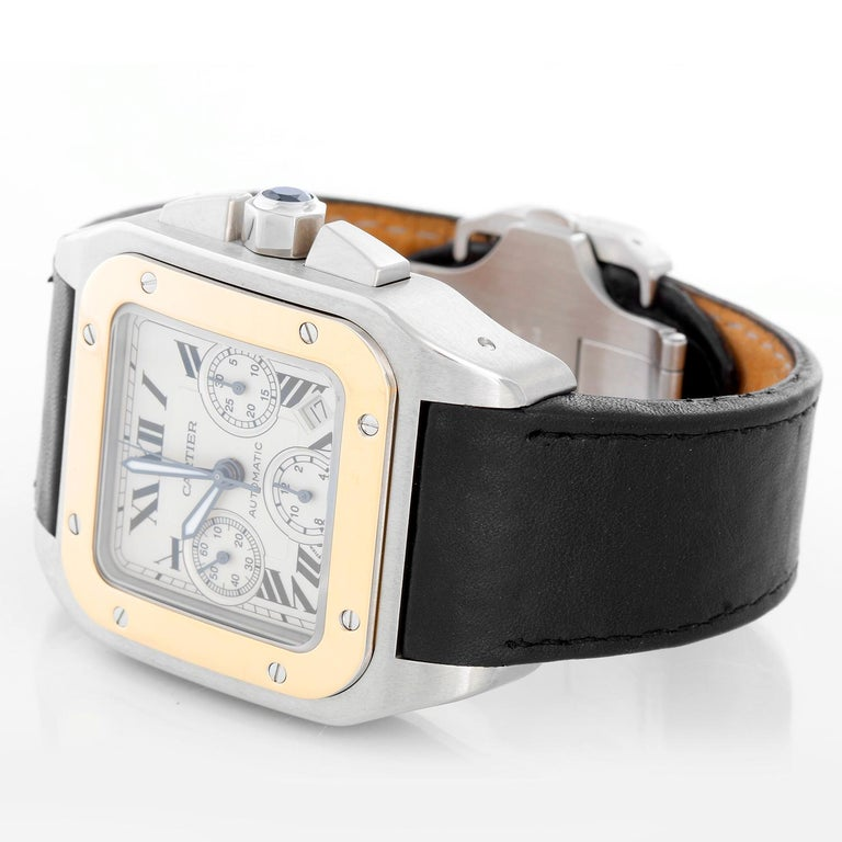 Cartier Santos 100 XL  Chronograph Two Tone Men's Watch 2740 -  Automatic winding chronograph with date. Stainless Steel case with yellow gold bezel (41mm x 55mm). White Chronograph dial with Roman Numerals. Cartier Kevlar/leather strap with Cartier