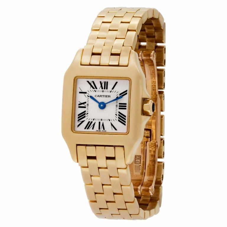 A must have classic Cartier watch showcasing an 18k yellow gold case and bracelet measures 20x20mm. The watch comes complete with the Cartier box and has been serviced and polished.  Retail Price: 19,000 + Tax