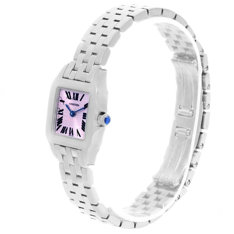 Cartier Santos Demoiselle Purple Dial Small Ladies Watch W2510002. Quartz movement. Stainless steel case 20.0 x 20.0 mm. Octagonal crown set with the blue faceted spinel. Stainless steel fixed bezel. Scratch resistant sapphire crystal. Lacquered