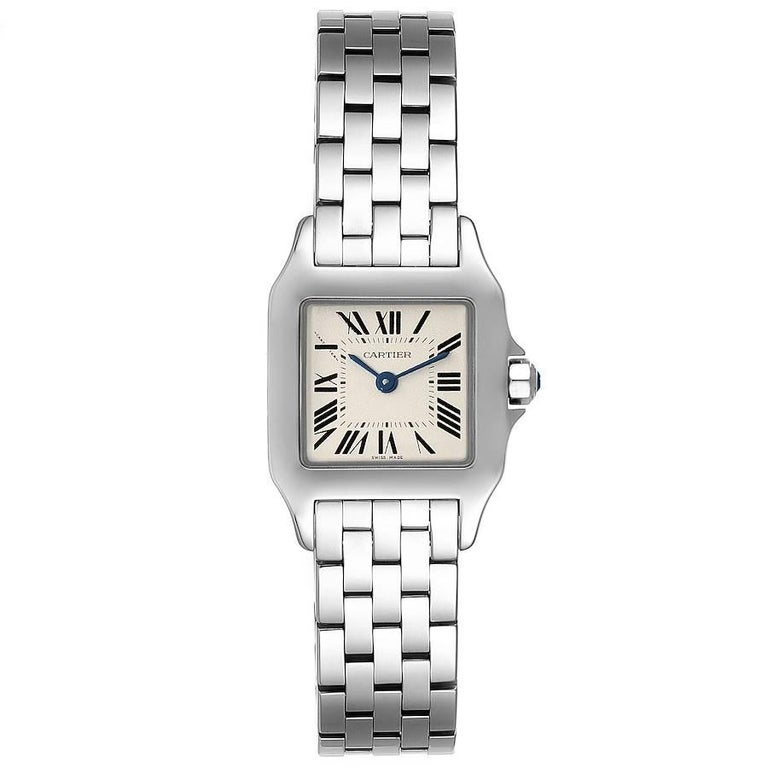 Cartier Santos Demoiselle Stainless Steel Ladies Watch W25064Z5 Box Papers. Quartz movement. Stainless steel case 20.0 x 20.0 mm. Octagonal crown set with the blue faceted spinel. . Scratch resistant sapphire crystal. Silvered grained dial. Painted