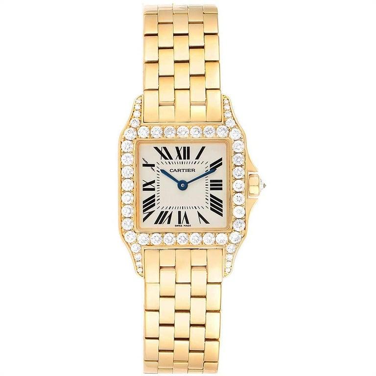 Cartier Santos Demoiselle Yellow Gold Diamond Midsize Ladies Watch WF9002Y7. Quartz movement. 18K yellow gold case 26.0 x 26.0 mm. Octagonal crown set with the diamond. Original Cartier factory diamond bezel. Scratch resistant sapphire crystal.