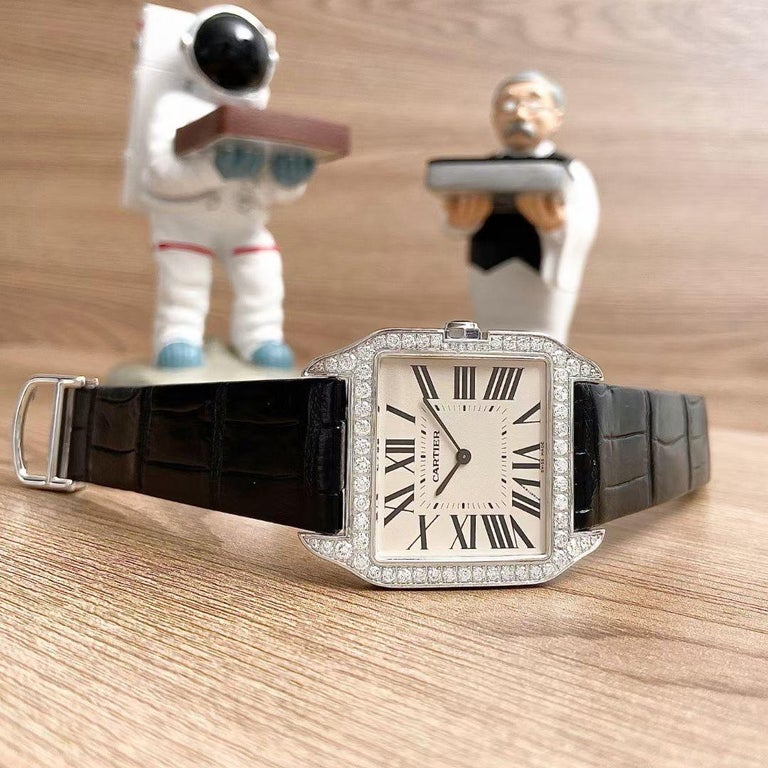 This Is A Men's Cartier Santos Dumont Diamond 18K Solid White Gold Watch  With A Suggested Retail Price Of £33,300 We got it at a very good price. This wonderful piece is truly a bargain!  Brand Cartier Model Santos Dumont Reference number