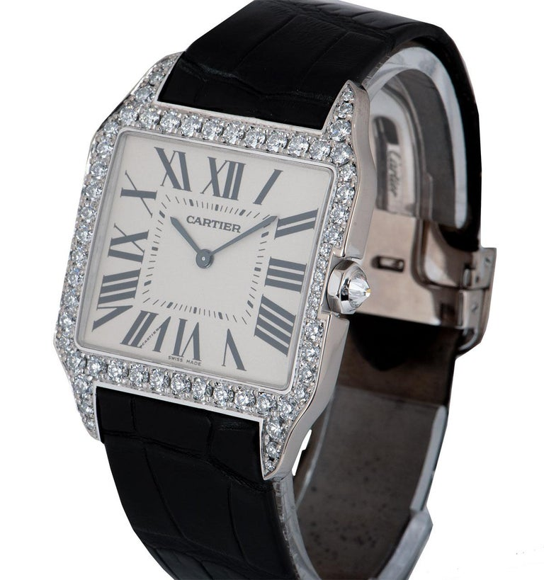A 34.6 mm 18k White Gold Santos Dumont Gents Wristwatch, silvered grained dial with roman numerals and a secret signature at