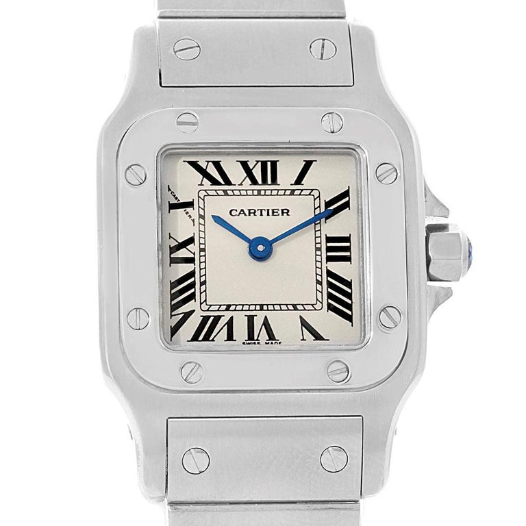 Cartier Santos Galbee Small Steel Silver Dial Ladies Watch W20056D6. Quartz movement. Stainless steel case 24.0 x 24.0 mm. Steel octagonal crown set with the faceted spinel. Stainless steel bezel punctuated with 8 signature screws. Scratch resistant