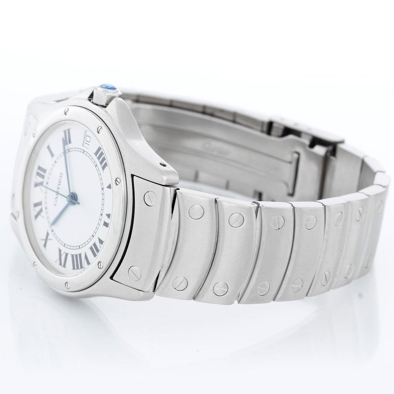 Cartier Santos Men's/Ladies Midsize 33mm Stainless Steel Automatic Watch - Automatic. Stainless steel case (33mm diameter). White dial with black Roman numerals. Stainless steel bracelet; will fit up to a 7 inch wrist. Pre-owned with custom box.