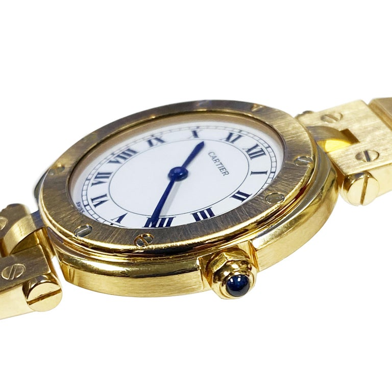Circa 1990 Cartier Vendome collection Wrist Watch, 27 M.M. 3 piece water resistant case, Quartz Movement, Sapphire Crown, White Dial with Black Roman Numerals. 1/2 inch wide Santos Link Bracelet with Fold over Deployment clasp. Watch length 6 1/2