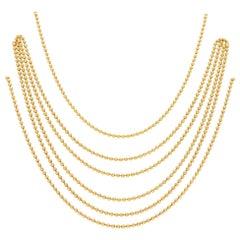 Cartier Six Strand Draperie Necklace Set in 18 Karat Yellow Gold