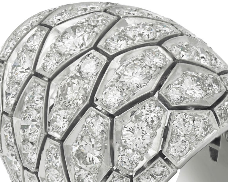 CARTIER convex ring in white gold, Snake Skin pattern, paved with diamonds.  Signed and numbered.  (30,55 grs) Diamond : 7.80 carats Quality color F, clarity VVS.