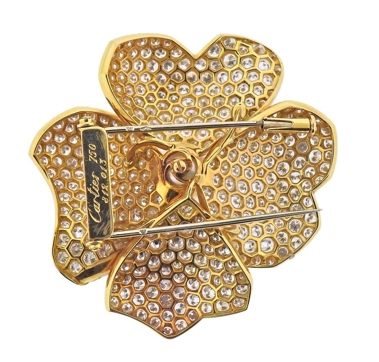 Impressive 18k gold flower brooch by Cartier, set with approx. 15 carats in diamonds and a 10mm South Sea pearl. Brooch measures 46mm x 45mm. Marked: Cartier, 750, 812 013. Weight - 23.1 grams.