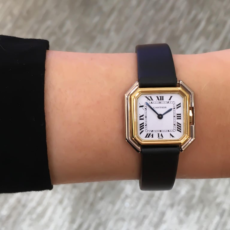 Cartier Square Hexagonal Godron 18K Two-Tone Mechanical Watch Fabric Strap  MOVEMENT: MECHANICAL HAND-WINDING CASE MATERIAL: 18 KARAT WHITE AND YELLOW GOLD CONDITION: EXCELLENT PRE-OWNED WITH MINOR SCRATCHES ON  CRYSTAL. NEW STRAP. CASE