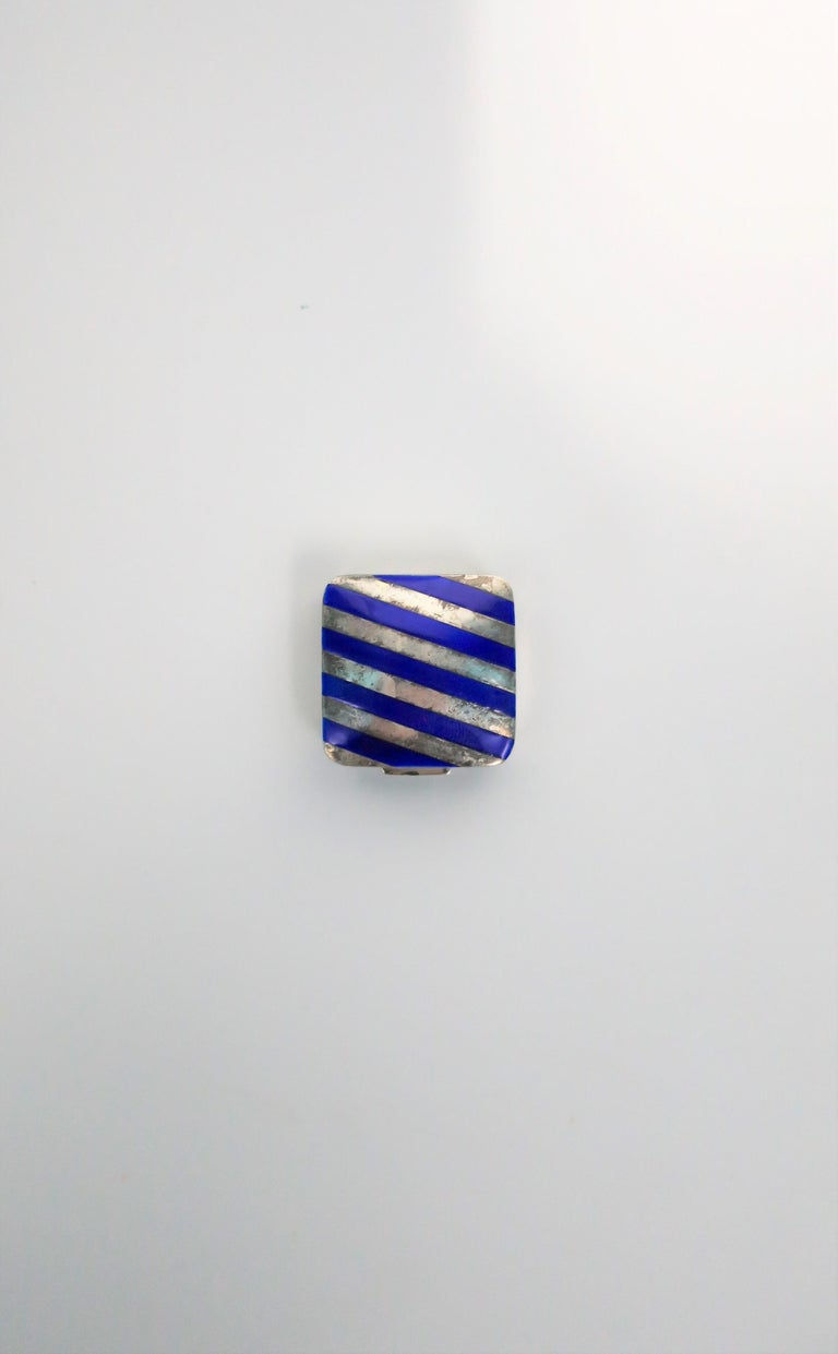 From French luxury maker Cartier, a very beautiful and rare sterling silver and cobalt blue enamel pill box, circa 20th century. Box has a nice weight to it. Piece is marked: