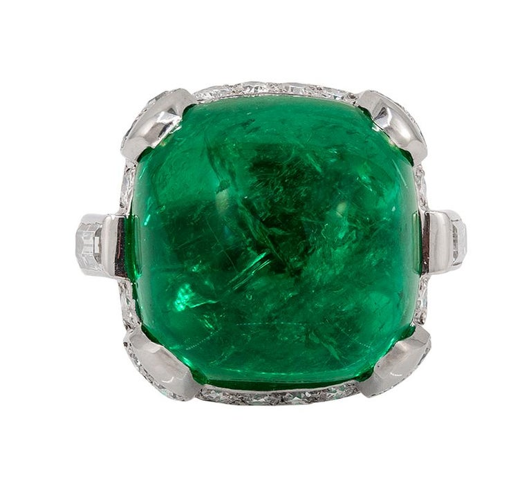 """CARTIER Sugar Loaf Emerald Ring. An art deco platinum ring, set with diamonds and sugar loaf emerald, signed and numbered Cartier. ring size 7.5 Signed """"Cartier""""; circa 1920's; with serial number Condition: Good - Previously owned and gently worn,"""