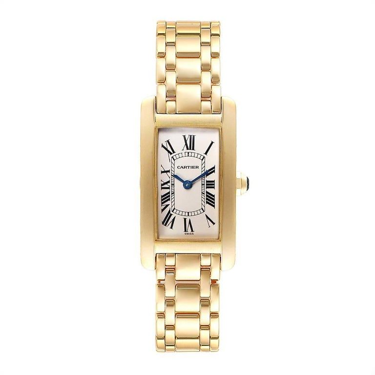 Cartier Tank Americaine 18K Yellow Gold Ladies Watch W26015K2. Quartz movement. 18K yellow gold case 19.0 x 35.0 mm. Circular grained crown set with faceted blue spinel cabochon. Scratch resistant sapphire crystal. Silvered grained dial with black