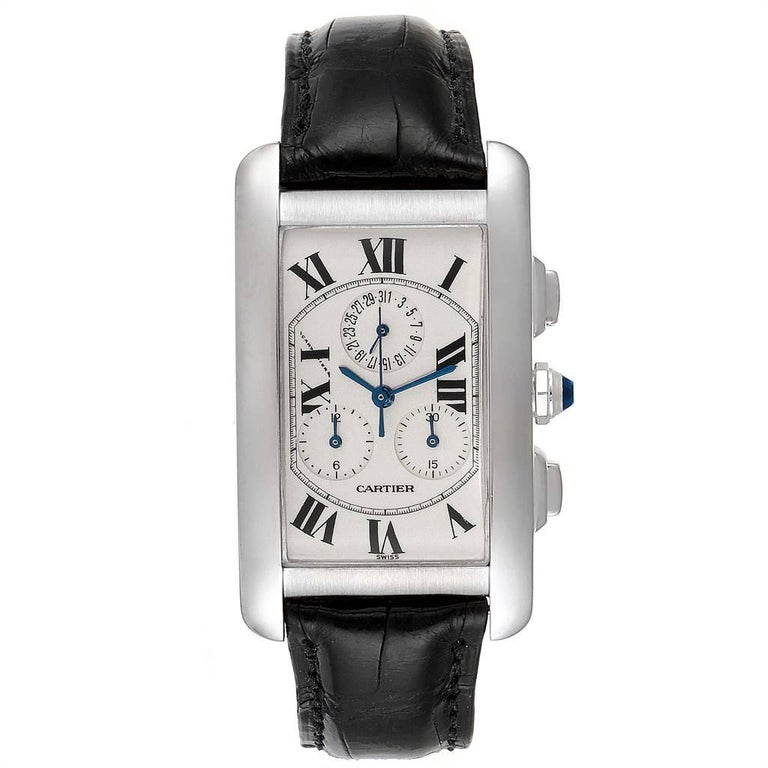 Cartier Tank Americaine Chronograph White Gold Mens Watch W2603358. Quartz movement. 18K white gold case 26.6 x 45.1 mm. Circular grained crown set with faceted blue spinel cabochon. 18K white gold bezel. Scratch resistant sapphire crystal. Silvered