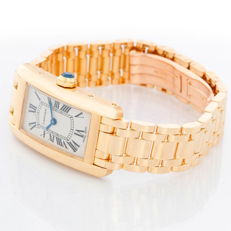 Cartier Tank Americaine Ladies 18k Yellow Gold Watch 2482 - Quartz. 18k yellow gold case (19mm x 35mm). Ivory colored dial with black Roman numerals. 18K yellow gold Cartier bracelet; will fit a 6 inch wrist . Pre-owned with Cartier box.