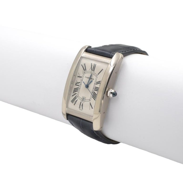 Cartier Tank Americaine Large 18k White Gold Watch, reference W2603256. 26.6 x 45.1 mm, Automatic movement. On a navy Cartier leather strap with a 18k white gold Cartier buckle.  Small scratches on crystal.