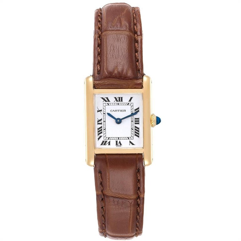 Cartier Tank Classic Paris 18k Yellow Gold Brown Strap Ladies Watch. Quartz movement. 18k yellow gold case 22.5 x 30.5 mm. Circular grained crown set with the blue sapphire cabochon. Mineral glass crystal. White dial with black roman numerals. Sword