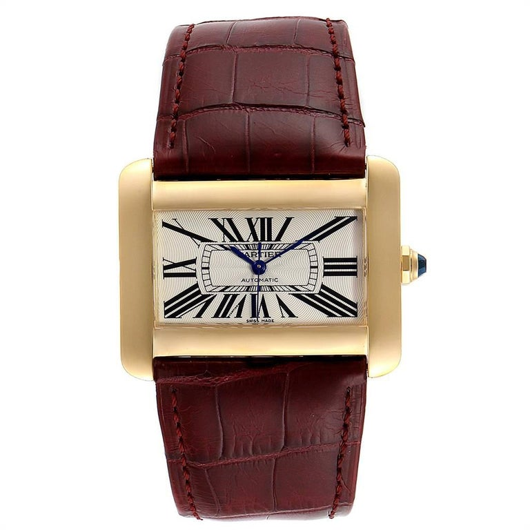 Cartier Tank Divan Large Silver Dial Yellow Gold Ladies Watch W6300856. Automatic self-winding movement. 18K yellow gold case 38.0 x 30.0 mm. Circular grained crown set with the faceted sapphire. 18K yellow gold bezel. Scratch resistant sapphire