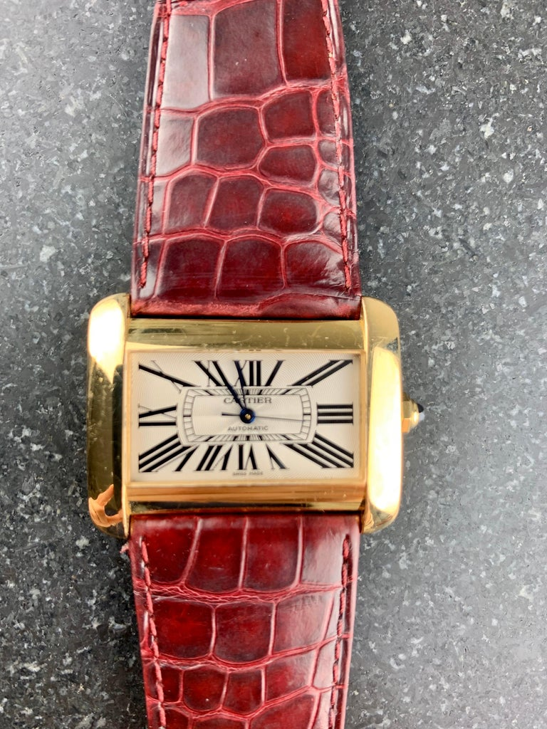 Cartier Tank Divan XL Ref. 2603 18 Carat Yellow Gold 38 mm Automatic Watch.  Champagne Dial With Black Roman Numerals And Blue Steel Hands. 18 Carat Gold Case And Buckle With Sapphire Crystal. Case Size 30 mm x 38 mm. Water Resistant. Original