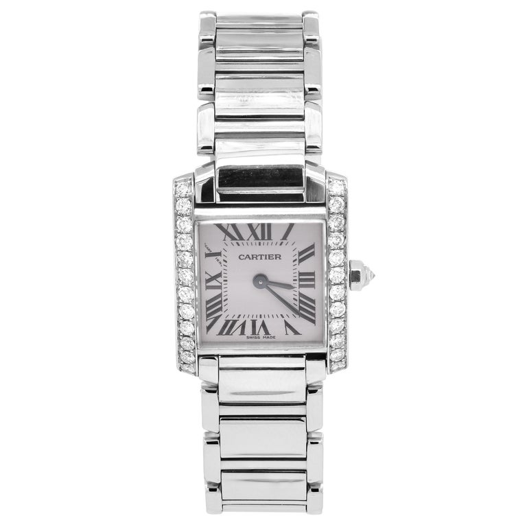 Cartier Tank Francaise Stainless Steel White  Diamond Bezel Ladies Watch 2384  Mint condition. Comes with original Cartier box.  Case Material: Stainless Steel Case Diameter: 20mm x 25mm Crystal: Diamond  0.80 carat G color, VS clarity diamonds.