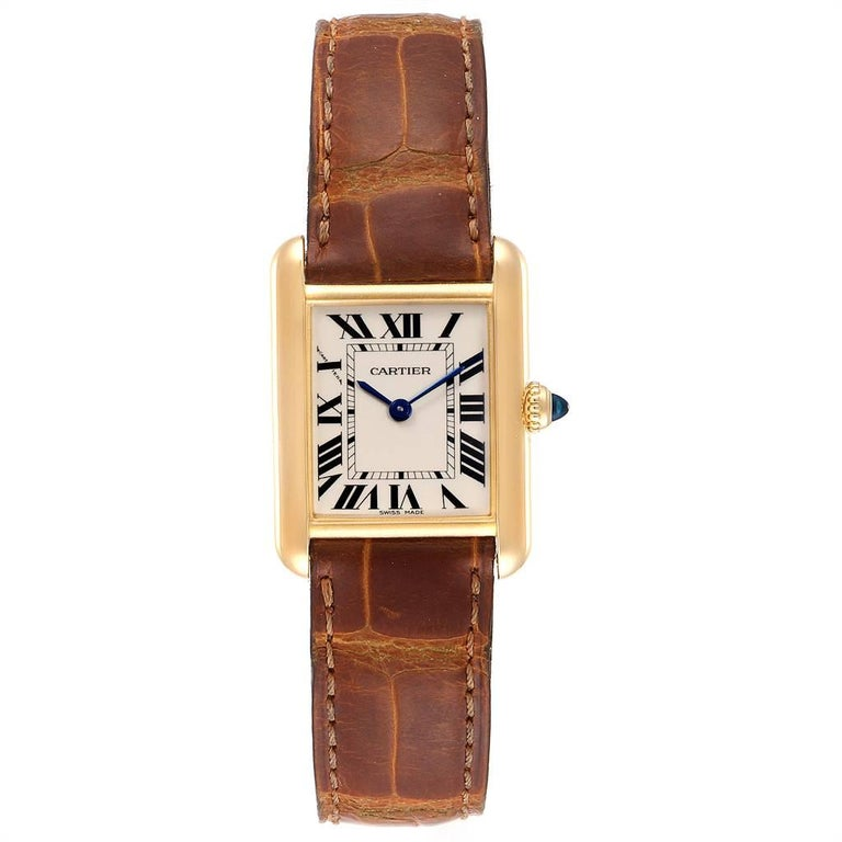 Cartier Tank Louis 18k Yellow Gold Brown Strap Ladies Watch W1529856. Quartz movement. 18k yellow gold case 29.0 x 22.0 mm. Circular grained crown set with the blue sapphire cabochon. Scratch resistant sapphire crystal. Silvered grained dial.