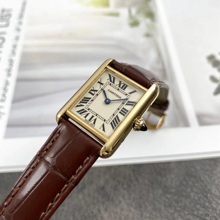 The Cartier Tank Louis Small Ladies' Watch was inspired by the classic design that was once worn by Louis Cartier himself.  This stunning 22mm 18ct yellow gold case with 18ct yellow gold circular-grained crown set with a sapphire cabochon, fastens