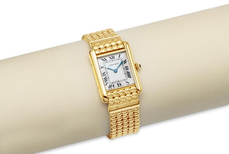 Case: Square case measuring 21mm x 28mm (lug to lug). Made in 18k yellow gold. Screw case back engraved