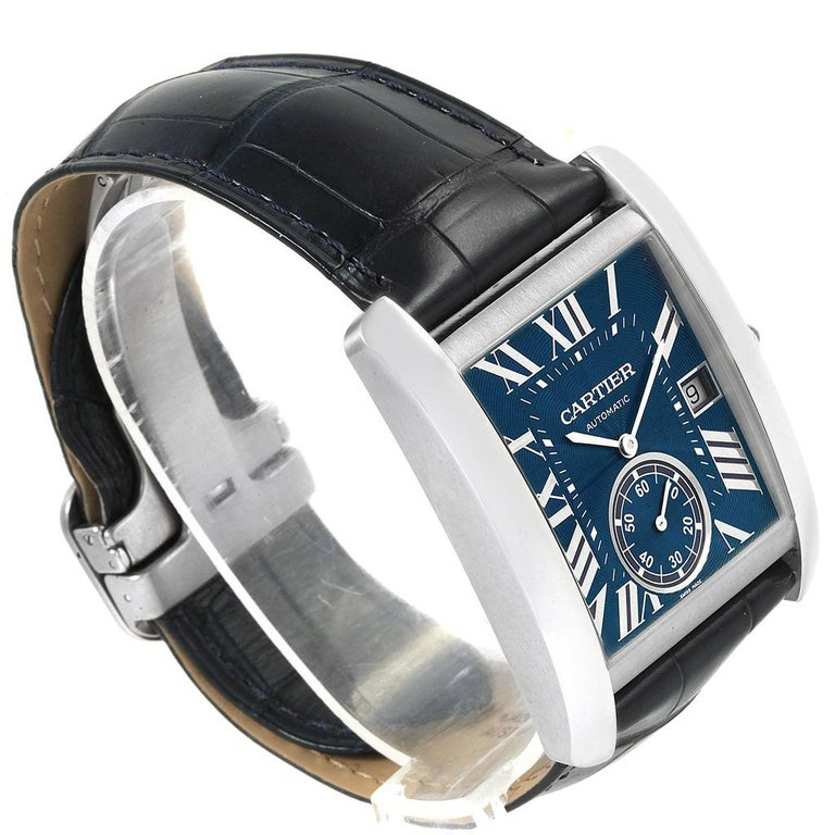 Cartier Tank MC Blue Dial Automatic Mens Watch WSTA0010 Box Papers. Automatic self-winding movement caliber 1904-PS. Three body brushed stainless steel case 34.3 x 44.0 mm. Protected octagonal crown set with the faceted blue spinel. Exhibition case