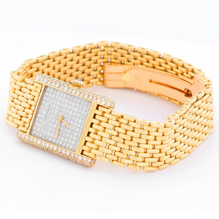 Cartier Tank Pave Diamond Ladies Watch  - Manual . 18K Yellow gold case with pave diamonds  ( 28 x 28 mm) . Pave diamond dial . 18K Yellow gold mesh bracelet; will fit a 6 3/4 inch wrist . Pre-owned with Cartier box .