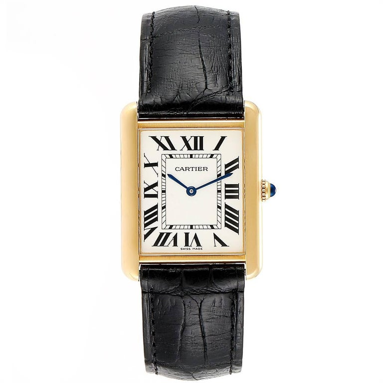 Cartier Tank Solo Yellow Gold Steel Black Strap Mens Watch W1018855. Quartz movement. 18k yellow gold/steel back case 34.0 x 27.0 mm. Circular grained crown set with the blue spinel cabochon. Scratch resistant sapphire crystal. Silver opline dial.