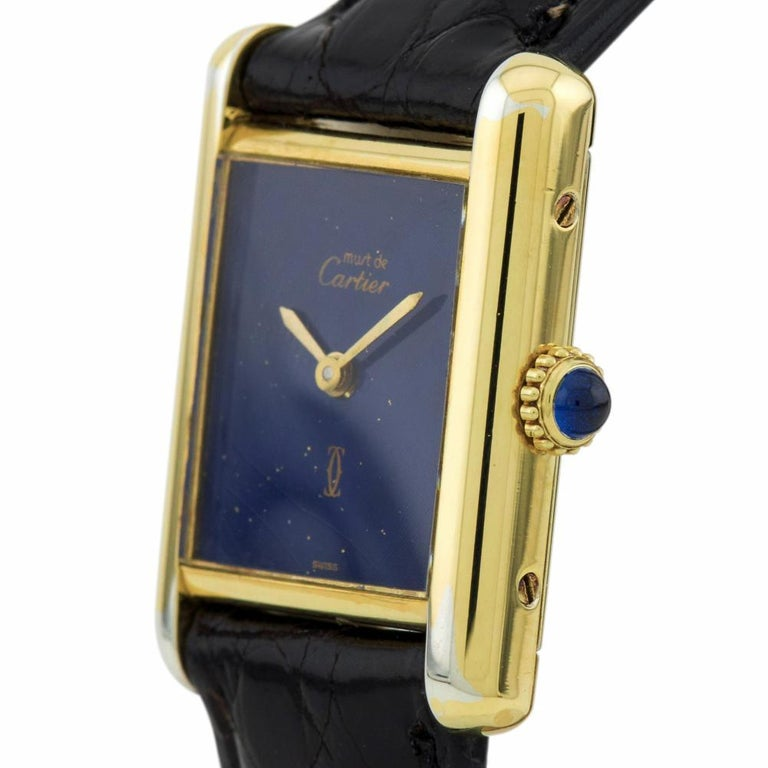 Cartier Tank Vermeil Reference #:Vintage. Pre-Owned Cartier Classic Tank, Reference: Vintage, Year: 1990*.  20.00mm Vermeil Case, Vermeil Bezel, Blue Dial, Leather Solid Bracelet with Tang  Buckle.  Manual Wind Movement, Function(s): Time Only.  Box