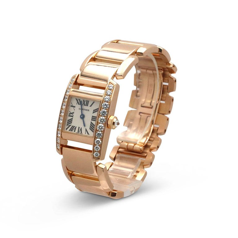Authentic Cartier 'Tankissime' ladies watch crafted in 18 karat rose gold with diamond bezel.  The case measures 30mm x 20mm with a silvered dial and Roman Numeral hour markers and is accented by a diamond bezel and diamond-set crown.  The 18 karat
