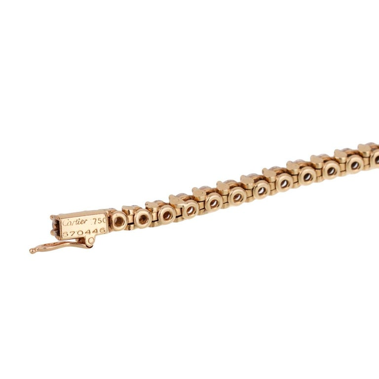 An extremely rare Cartier tennis diamond anklet featuring 77 round brilliant cut diamonds measuring 4ct appx of the finest cartier diamonds set in 18k yellow gold.   The anklet measures 9.5