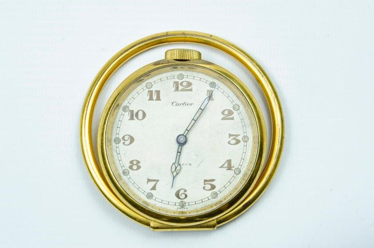 Cartier travel clock (on table) this watch is with its original box golden metal - Cortland watch machine Swiss origin, circa 1930.
