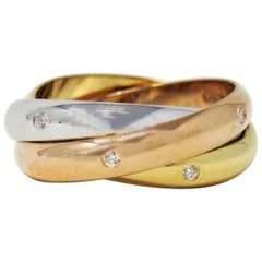 Cartier Tri Color 18 Karat Gold and .19 Carat Total Diamond Trinity Band Ring