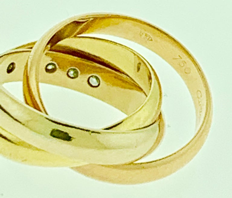 Cartier  Trinity, Tri Color Gold and 5 Diamond Ring 18 Karat Yellow Gold In Good Condition For Sale In New York, NY