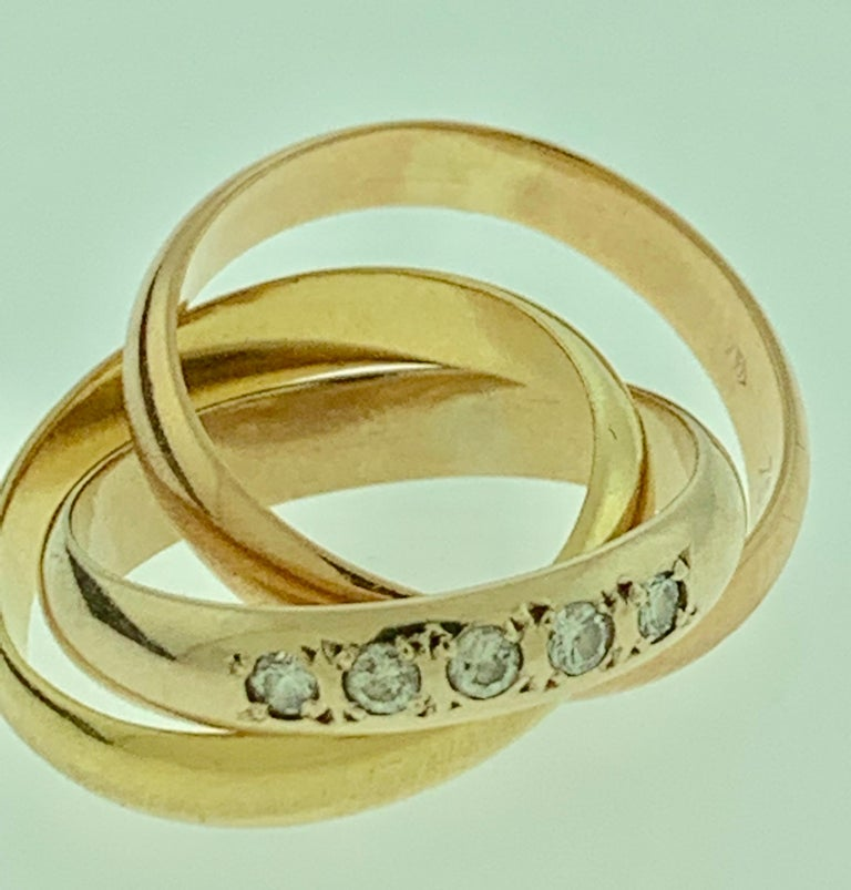 Cartier Tri Color Gold And  5 Diamond Ring 18 Karat Yellow Gold, Size 5 1/2 One of the ring has 5 round diamonds. Color of the rings are not very distinctly different from each other. one yellow , one Rose and one White Metal:18k Tri-Color