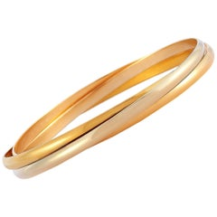 Cartier Trinity 18 Karat White, Yellow and Rose Gold Rolling Bangle Bracelet