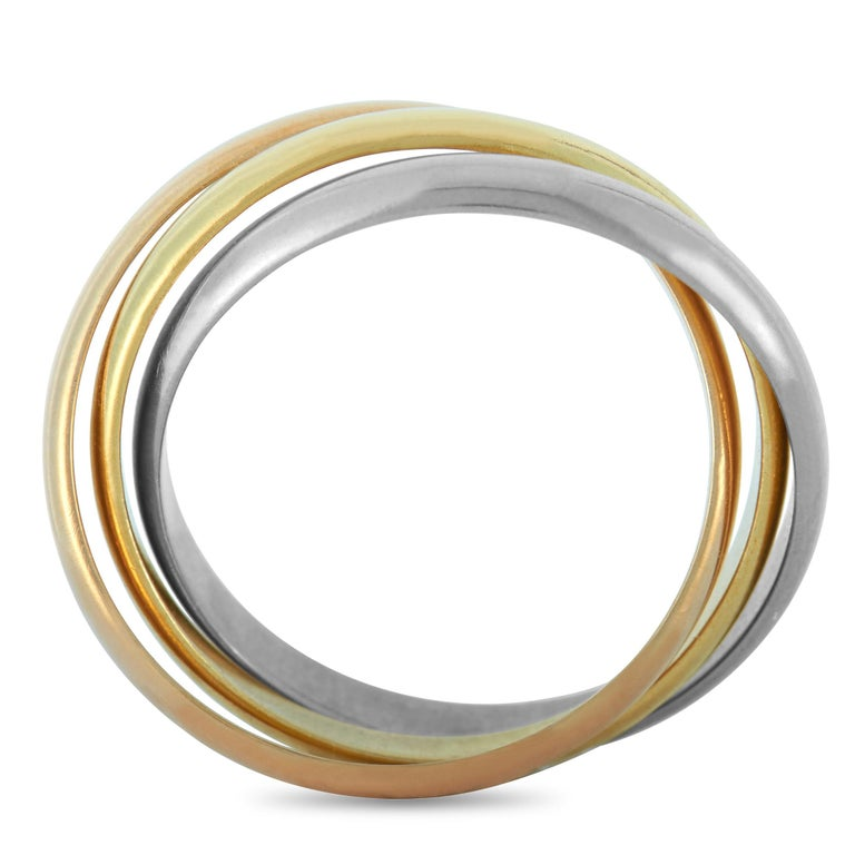 """The Cartier """"Trinity"""" ring is made out of 18K yellow, white and rose gold and weighs 4.7 grams, boasting band thickness of 6 mm.    This item is offered in estate condition and includes the manufacturer's box and papers."""