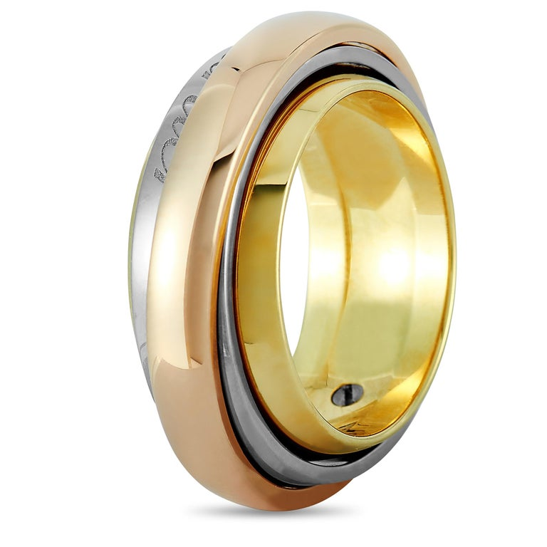 """The Cartier """"Trinity"""" ring is made out of 18K yellow, white and rose gold and weighs 21.2 grams, boasting band thickness of 10 mm.    The ring is offered in estate condition and includes a gift box."""