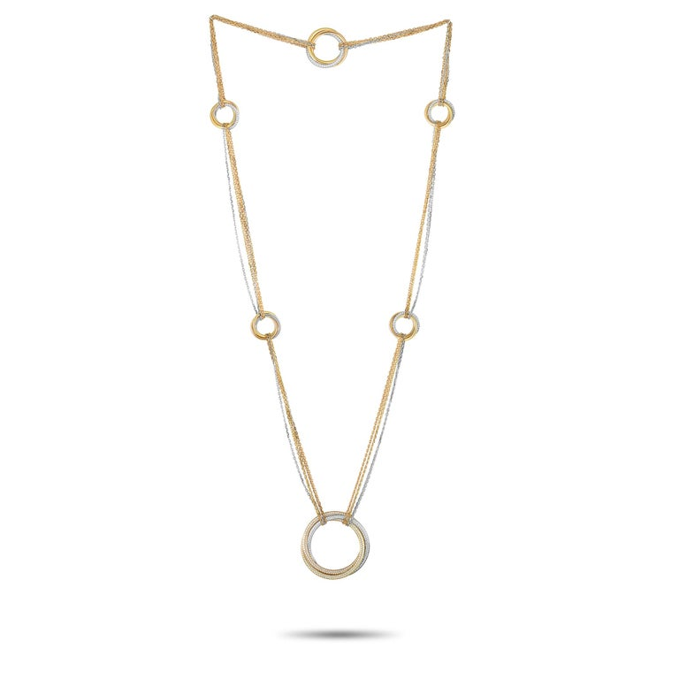 """The Cartier """"Trinity"""" necklace is made out of 18K white, yellow and rose gold and embellished with diamonds. The necklace measures 30"""" in length and boasts a 1.25"""" by 1.25"""" pendant. This item weighs 75.2 grams.  Offered in estate condition, the"""