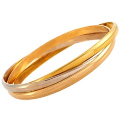 Cartier Trinity 18 Karat Yellow, White and Rose Gold Rolling Bangle Bracelet