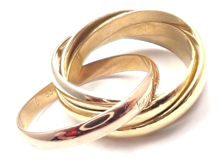 18k Tri-Color Gold Trinity 5 Band Ring by Cartier. Details: Ring Size: European 53, US 6 1/4 Band Width: 9mm Weight: 8.8 grams Stamped Hallmarks: Cartier Paris 53 Serial Number Omitted *Free Shipping within the United States* YOUR PRICE: